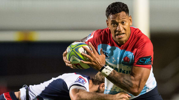 Israel Folau of the Waratahs takes on the Rebels defence in the recent trial game.