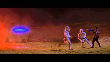 Kylo Ren uses the force to stop a blaster beam before it can hit him in <i>Star Wars: The Force Awakens</i>.