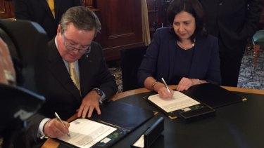Star Entertainment chairman John O'Neill signs the final Queens Wharf Brisbane contract with Premier Annastacia Palaszczuk.