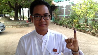 Former political prisoner Nay Phone Latt, who is standing for the opposition National League for Democracy, after voting for the first time.