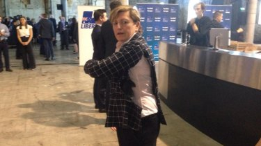 Tony Abbott's sister, Christine Forster, says protesters badly ripped her jacket at the event.