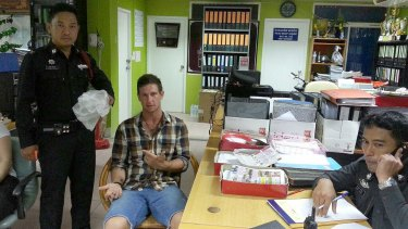 Jacob Saveisberg with police after allegedly stealing two raw prawns.