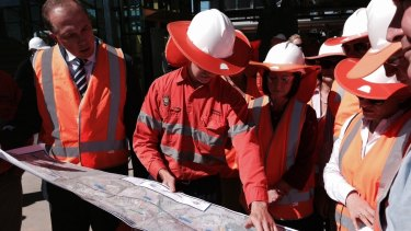 Queensland Transport Minister Jackie Trad and federal minister Peter Dutton get a progress report.