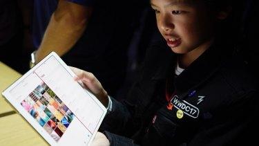 10-year-old Australian app developer Yuma Soerianto uses the new iPad Pro.