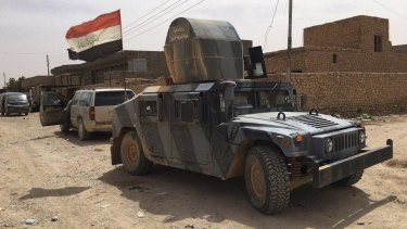 Iraqi security forces on patrol on Sunday. after defeating Islamic State militants in Fallujah