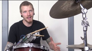 Jason Barnes' robot prosthesis allows him to drum faster than an able-bodied drummer.