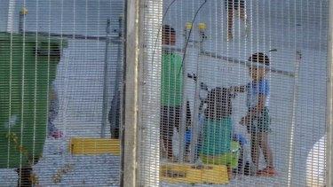 An Amnesty International photograph of children playing near the refugee processing centre on Nauru.