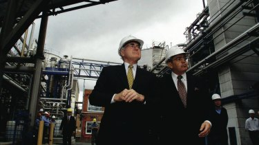 Manildra's Dick Honan shows then prime minister John Howard around the company's ethanol plant in Bomaderry.