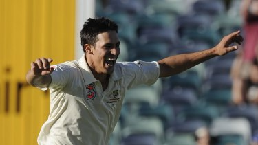 On fire: Mitchell Johnson claims the wicket of Morne Morkel.