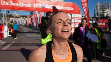 Cassie Fien finishes the City2Surf as the first placed women's runner.
