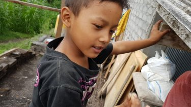 Gede Epo from Nawa Kerti village five kilometres from Mount Agung summit shows ash he picked from the roof.