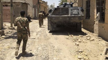Iraqi security forces in Fallujah's  al-Julan neighborhood on Sunday after defeating Islamic State militants.