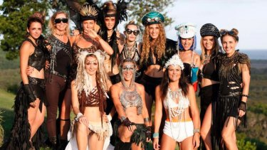Miley Cyrus, centre back, and her crew on New Years Eve in Byron Bay.