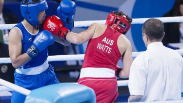 It was war: Shelley Watts lands a blow on Laishram Devi of India.
