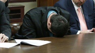 Guilty: Daniel Holtzclaw puts his head on the table and cries as the verdicts are read.