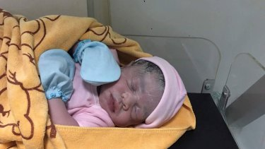 Cambodian Lux Clinic posted a photo of a minutes-old baby girl on Facebook following Hour Vanny's ceasarean on August 25. The surrogate mother confirmed the girl was the baby she carried.