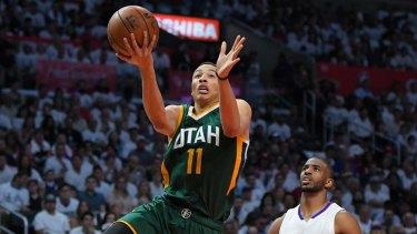 Utah Jazz guard Dante Exum (left) shoots as Los Angeles Clippers guard Chris Paul defends.