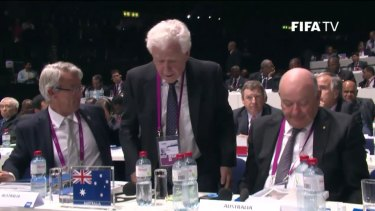 Frank Lowy, the head of the Football Federation Australia, casts his ballot in Zurich.