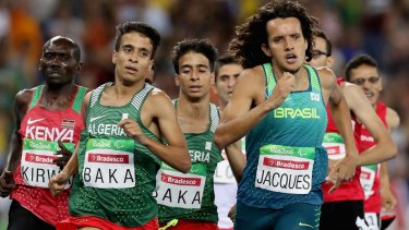 Abdellatif Baka of Algeria and Yeltsin Jacques of Brazil lead the pack in the men's 1500m T13 final at Olympic Stadium.