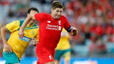 Gerrard in Australia: The Liverpool star on the run against the Australian Legends at ANZ Stadium in January.