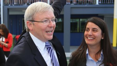 Then prime minister Kevin Rudd waves to children during a visit to Brisbane Adventist College with Laura Fraser Hardy in 2013.