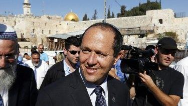 Jerusalem Mayor Nir Barkat (centre) walks after praying at the Western Wall in Jerusalem's Old City in 2013.