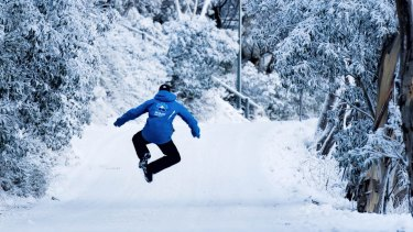 A Mt Buller ski instructor jumps for joy at the sight of fresh snow.