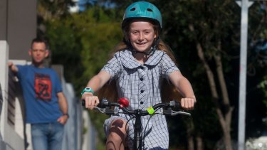 Macy will have to stop riding on the footpath when she turns 12 under NSW law.