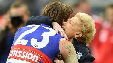 Susan Alberti celebrates the Bulldogs' premiership with with Jordan Roughead.