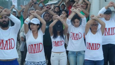Refugees at Nauru wear t-shirts with Omid's name as a show of solidarity.