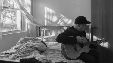 Perry Keyes is most comfortable sitting on his bed writing songs.