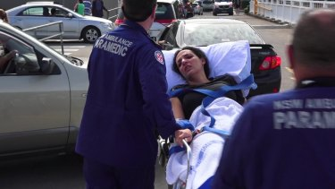 Innocent bystander: a woman receives treatment after the Bankstown shooting.