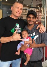 Danny Green with an Indigenous fan and his daughter ahead of Friday's fight.