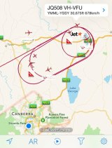 A map showing flights unable to land at Canberra Airport circling around Lake George.