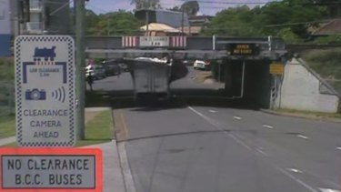 A truck smashes into the Allwood Street rail bridge in Indooroopilly.