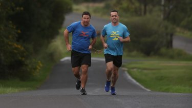 The duo run with a tether which helps the visually-impaired Nathan Johnston.