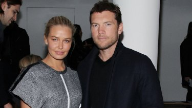 The paparazzi follow Lara and Sam Worthington around, here to New York City.