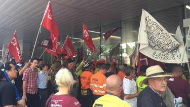 Union members protest the replacement of Australian shipping workers in Albert St, Brisbane.