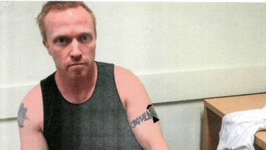 History of violence: Adrian Bayley in police custody after killing Jill Meagher.