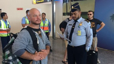 Ricky Longmuir waits to board his flight from Bali to Melbourne.