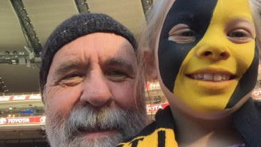 Firm fans: Martin Flanagan and Annie at the footy.