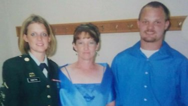 Tamara Turner (middle) with her two children; Natasha King (left) and Chuck Smith (right).