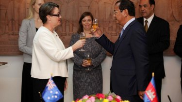 Australia's ambassador in Phnom Penh, Angela Corcoran, toasts the upgrading of ties with Cambodian's Minister of Foreign Affairs Prak Sokhonn on Wednesday.