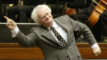 Richard Gill's colourful conducting style captivates children in an introduction to music in 2004.