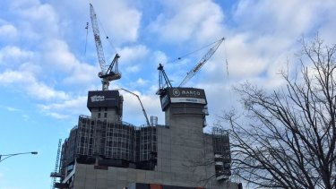 The crane partially collapsed just before 4pm on Friday.