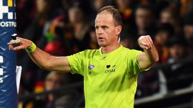Charades: An umpire calls for a score review during round 14.