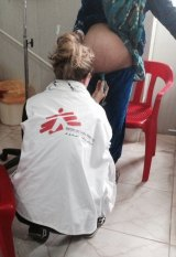 Elisha Swift examines a pregnant woman at the maternity unit in Domiz refugee camp.