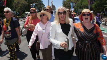 Marching in Sydney (from left): OzHarvest founder Ronni Kahn, lawyer Mariam Veiszadeh, and journalists Jane Caro and Tracey Spicer.
