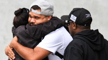 Lewis Warria hugs a supporter after leaving a Mental Health Court hearing into the deaths of seven of his siblings at the hands of his mother, Raina Thaiday.