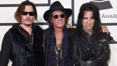 (L-R) Actor-musician Johnny Depp, musician Joe Perry, and singer Alice Cooper of the Hollywood Vampires at the 58th Grammy Awards.